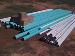 Stacks of 1.25—6 Inch PVC Pipe for a Custom Rainwater Collection System Installation